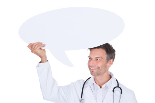 Portrait Of Happy Mature Male Doctor Holding Thought Bubble
