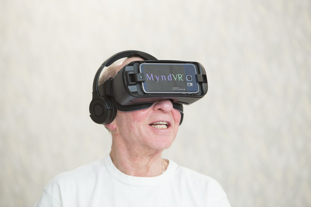 Senior man is wearing virtual reality goggles for MyndVR