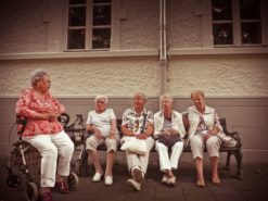 Seniors socializing outside in a group.