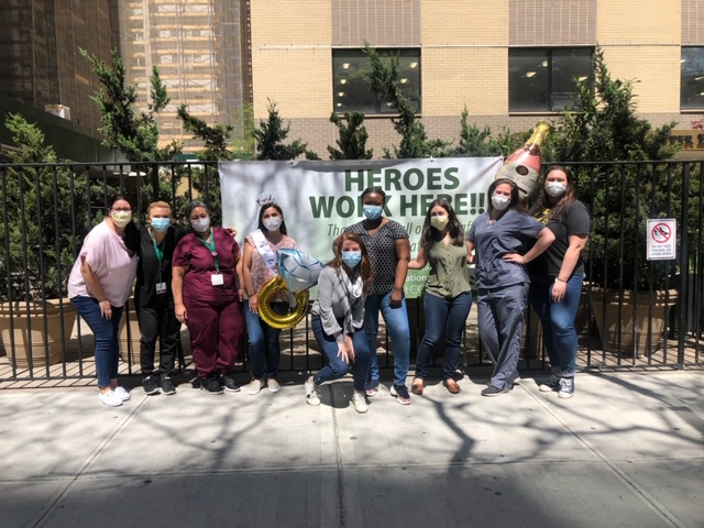 Nurses posing in front of UES Center